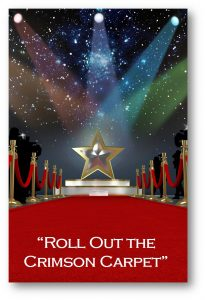 A gold star with rainbow-colored spotlights shining on it placed at the end of a long red carpet with the text: Roll out the crimson carpet.