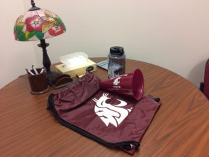 A table with some WSU items such as water bottles and bags.