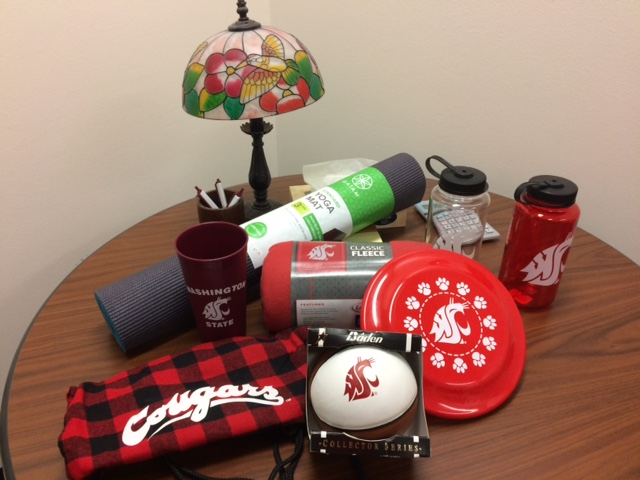 A variety of WSU items such as a frisbee and blanket.