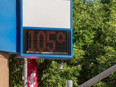 A digital sign showing the temperature as 105 degrees.