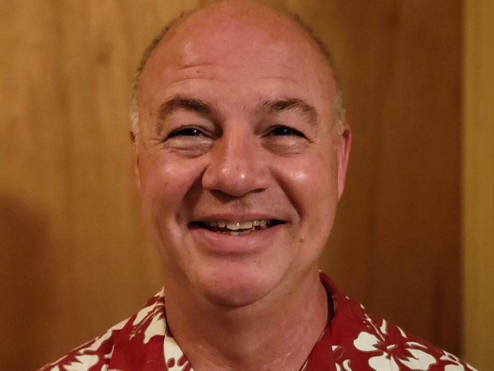 A smiling man.